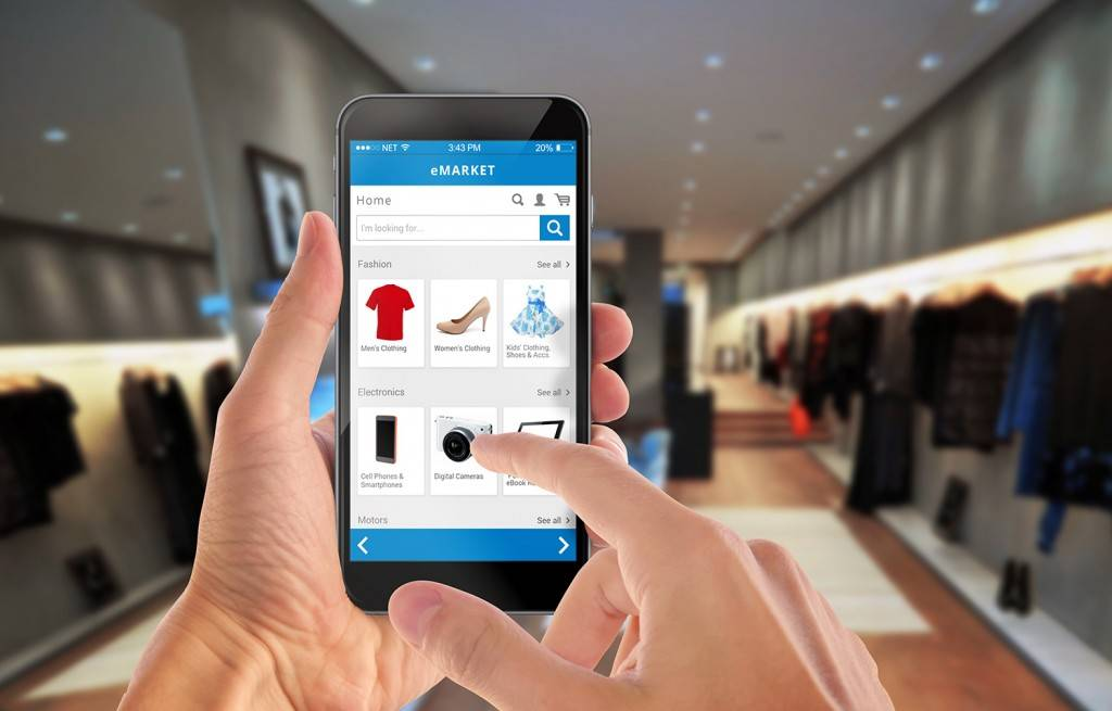 Smart phone online shopping in man hand. Shopping center in back